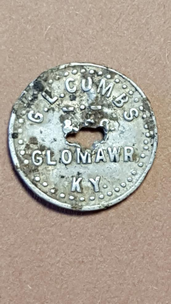 "Glomawr, Kentucky ""G.L Combs and Co."" 25 cent scrip.  Submitted by Patrick Hale and found while metal detecting on an old homesite in Perry County, KY.  Unknown company, any information about its history is welcomed."