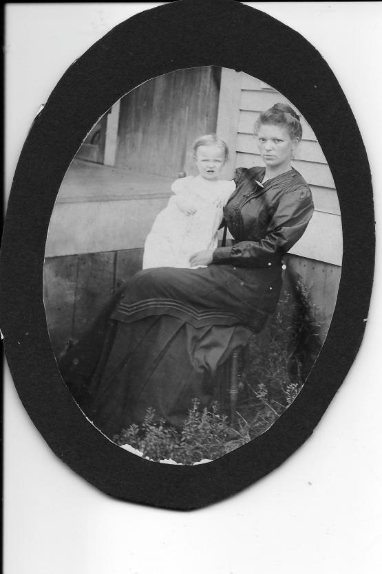 """Submitted by Andrew Jones 4/2/14: """"Photo of my Grandmother Davidson made in 1911 with my Uncle Edward Davidson. She indicated it was made by an itinerant photographer who was going house to house selling his skill of family photography.  A second photo is of two other uncles and aunt who were ready for the photo session, too---E.A. (Jack) Davidson, Vernon Davidson and Pansy Davidson (McKenzie)."""""""
