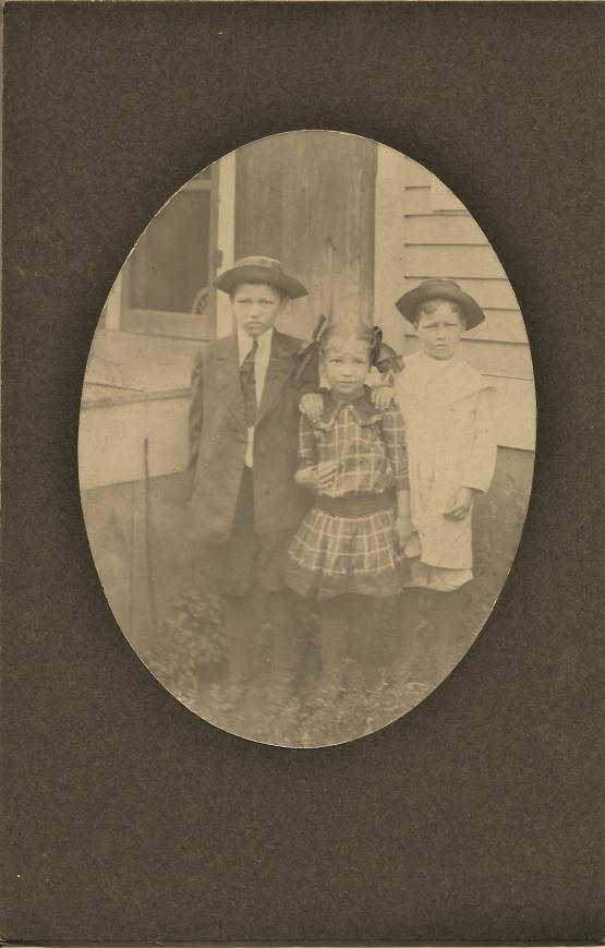 "Submitted by Andrew Jones on 4/2/14: ""My Grandmother Davidson indicated this photo was made by an itinerant photographer who was going house to house selling his skill of family photography.  This photo is of two other uncles and aunt who were ready for the photo session -E.A. (Jack) Davidson, Vernon Davidson and Pansy Davidson (McKenzie)."" (See photo entitled ""Granny and Uncle Ed"" for the other photo from this shoot.)"