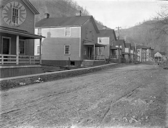 Cannel City Row, McRoberts, Kentucky.  From the Consolidation Coal Collection, Smithsonian National museum of American History.  SI Neg. CCC-1756. Date: 1918. Cement Walk & St. Improvements Cannel Row McR.