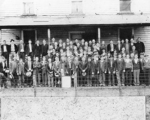 "Coal miners from the South East Coal Company, Millstone, Letcher County, Kentucky, taken in the 1930s in front of the boardinghouse in Millstone.  From the Kentucky Explorer, Feb. 2009. <a href=""http://kentuckyexplorer.com/nonmembers/2010-02pics.html"">http://kentuckyexplorer.com/nonmembers/2010-02pics.html</a>"