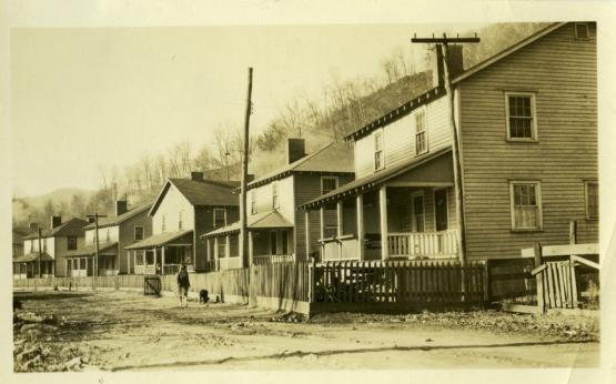 """Row of houses. &quot;Houses in the Cloversprint Coal Co. Camp, Harlan Co., Kentucky&quot; noted on back photo.  1931.  From the Hendon Evans Photographs collection, Accession Number pa82m1, University of Kentucky Special Collections.  <a href=""""http://kdl.kyvl.org/catalog/xt71zc7rnw6g_5_4/viewer"""">http://kdl.kyvl.org/catalog/xt71zc7rnw6g_5_4/viewer</a>"""