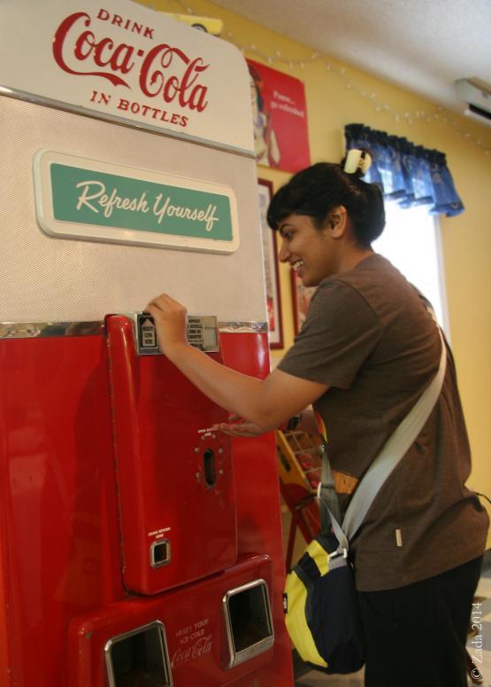 "University of Kentucky Appalachian Center&#039;s Fullbright scholar Saakshi Joshi using 1958 Coke machine inside Wayland Community Center.  Photo by Zada Komara 8/31/2014 <a href=""mailto:zko222@g.uky.edu"">zko222@g.uky.edu</a>"