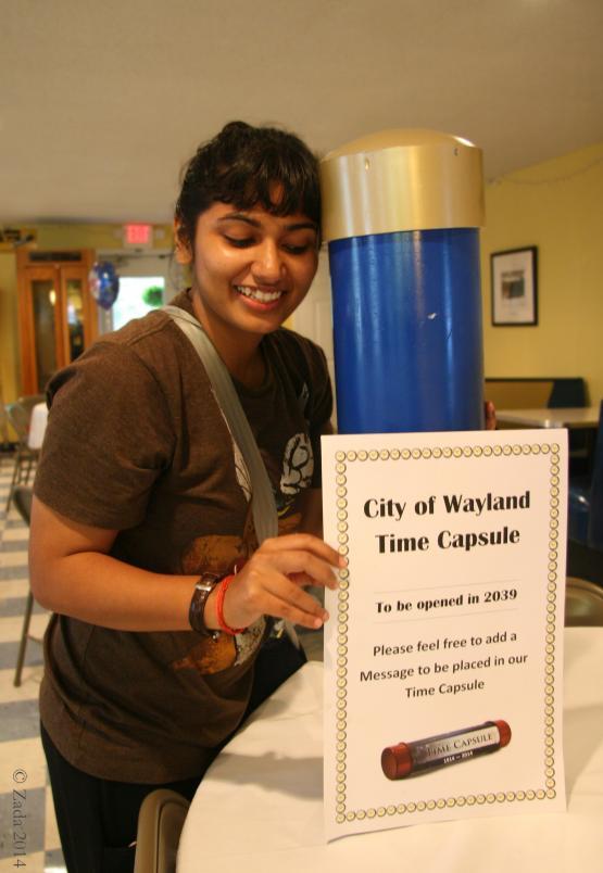 "University of Kentucky Appalachian Center&#039;s Fullbright scholar Saakshi Joshi holding time capsule built for Wayland&#039;s 2014 reunion inside Wayland Community Center.  Photo by Zada Komara 8/31/2014 <a href=""mailto:zko222@g.uky.edu"">zko222@g.uky.edu</a>"